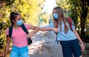 emozi-students-bumb-elbow-wearing-masks